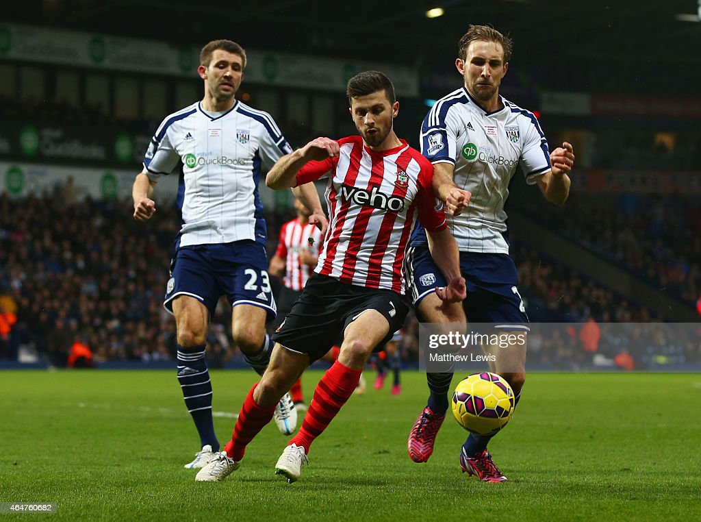 Shane Long of Southampton takes on Craig Dawson (R) and Gareth McAuley of West Bromwich Albion during the Barclays Premier League match between West Bromwich Albion and Southampton at The Hawthorns on February 28, 2015 in West Bromwich, England.