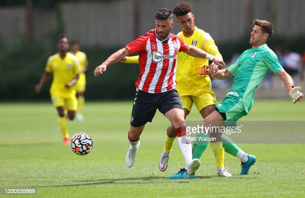Shane Long of Southampton wins the ball ahead of the Fulham defence during a pre-season friendly match between Southampton FC and Fulham at The...