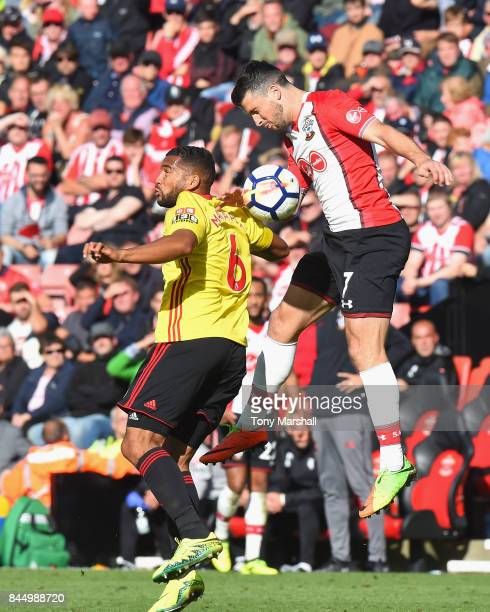 Shane Long of Southampton wins the ball in the air from Adrian Mariappa of Watford during the Premier League match between Southampton and Watford at...