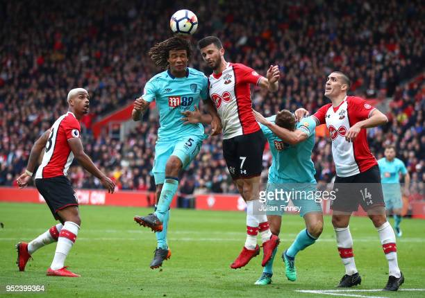 Shane Long of Southamton goes for a header with Nathan Ake of Bournemouth during the Premier League match between Southampton and AFC Bournemouth at...