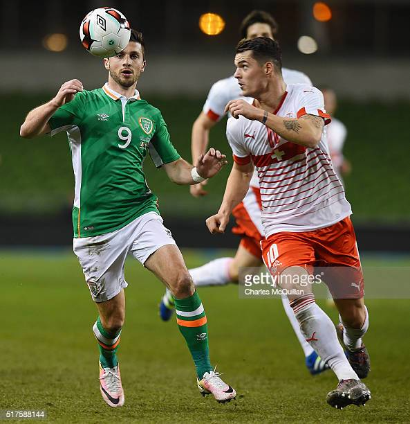 Shane Long of the Republic of Ireland and Granit Xhaka of Switzerland during the international friendly match between the Republic of Ireland and...