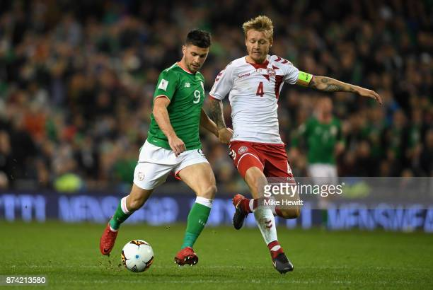 Shane Long of the Republic of Ireland and Simon Kjaer of Denmark battle for possession during the FIFA 2018 World Cup Qualifier PlayOff Second Leg...