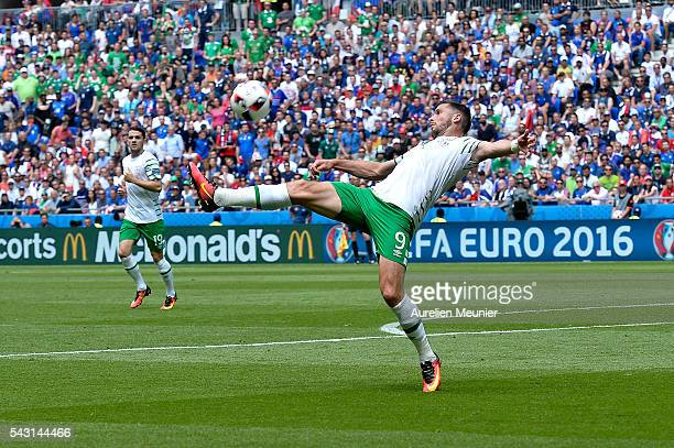 Shane Long of the Republic of Ireland controls the ball during the UEFA Euro 2016 round of 16 match between France and the Republic of Ireland at...