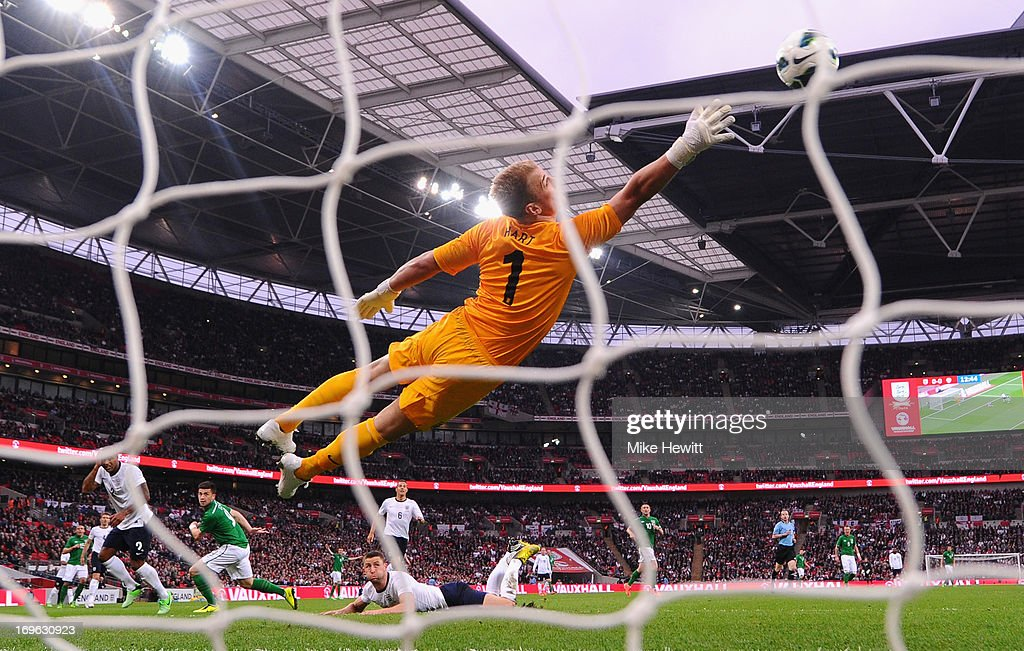 Shane Long of the Republic of Ireland (2L) heads the ball past Joe Hart of England to score their first goal during the International Friendly match between England and the Republic of Ireland at Wembley Stadium on May 29, 2013 in London, England.