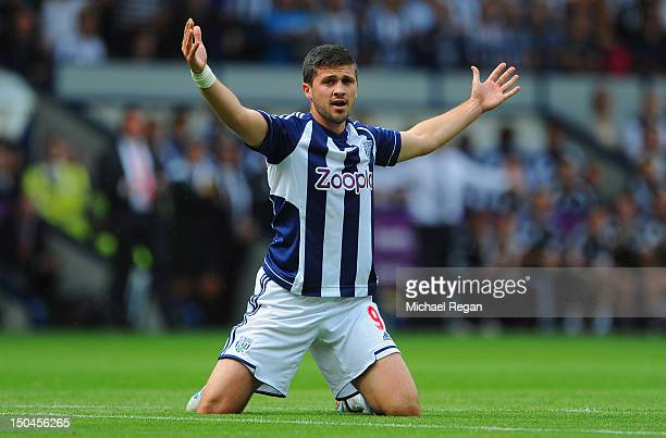 Shane Long of West Brom looks on during the Barclays Premier League match between West Bromwich Albion and Liverpool at The Hawthorns on August 18...