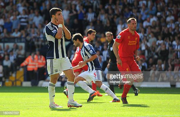 Shane Long of West Brom reacts after seeing his penalty saved during the Barclays Premier League match between West Bromwich Albion and Liverpool at...