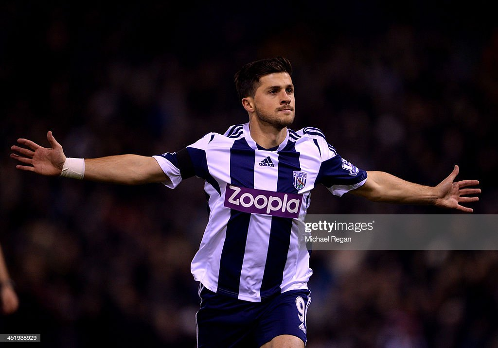 Shane Long of West Bromwich Albion celebrates as he scores their first goal during the Barclays Premier League match between West Bromwich Albion and Aston Villa at The Hawthorns on November 25, 2013 in West Bromwich, England.