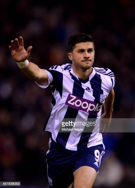 Shane Long of West Bromwich Albion celebrates as he scores their first goal during the Barclays Premier League match between West Bromwich Albion and...