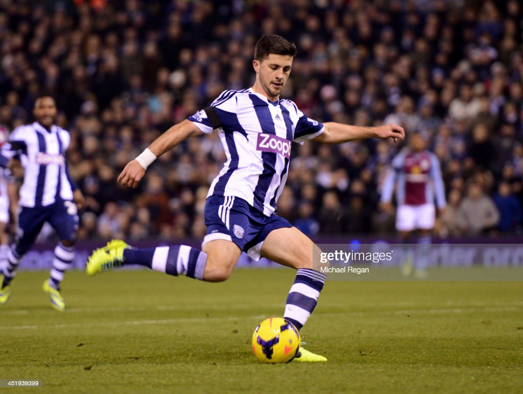Shane Long of West Bromwich Albion scores their second goal during the Barclays Premier League match between West Bromwich Albion and Aston Villa at The Hawthorns on November 25, 2013 in West Bromwich, England.