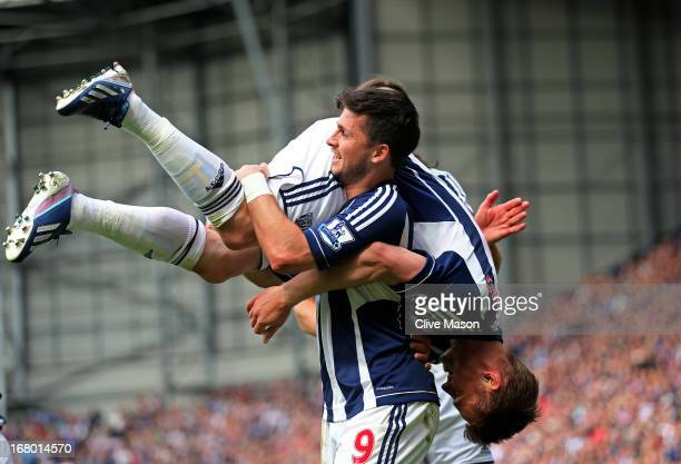 Shane Long of West Bromwich carries teammate Markus Rosenberg after scoring the opening goal during the Barclays Premier League match between West...