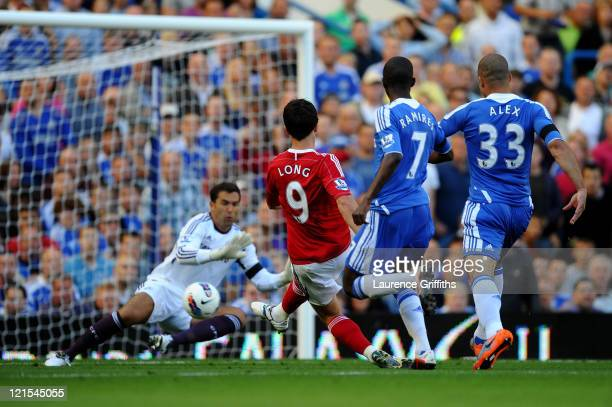Shane Long West Brom scores the opening goal past goalkeeper Henrique Hilario of Chelsea during the Barclays Premier League match between Chelsea and...