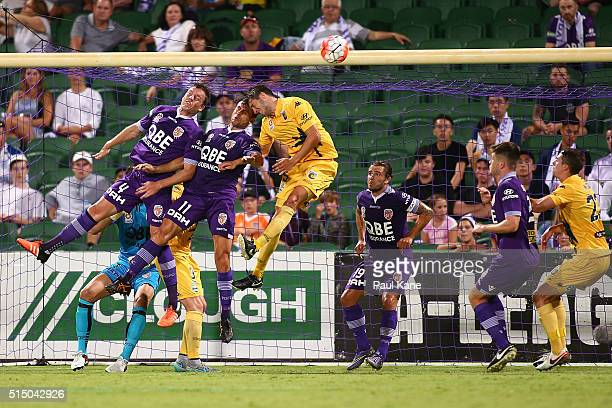 Shane Lowry and Richard Garcia of the Glory contest a header from a corner kick against Harry Ashcroft of the Mariners during the round 23 ALeague...