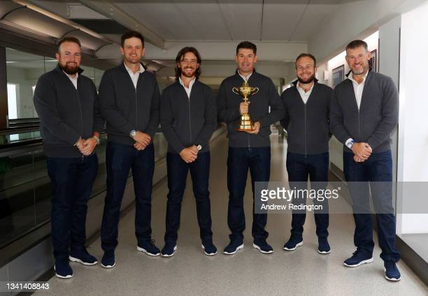 Shane Lowry, Bernd Wiesberger, Tommy Fleetwood, Captain Padraig Harrington, Tyrrell Hatton and Lee Westwood of Team Europe pose for a picture as they...