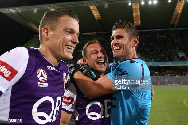 Shane Lowry Brendon Santalab and Liam Reddy of the Glory celebrate after becoming Premiers during the round 25 ALeague match between the Perth Glory...