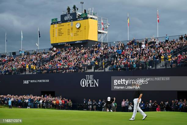 Shane Lowry of Ireland acknowledges the crowd after a putt on the 18th green during the third round of the 148th Open Championship held on the...