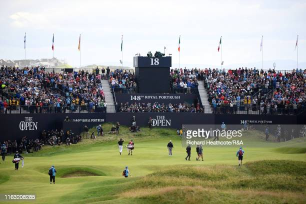 Shane Lowry of Ireland acknowledges the crowd as he approaches the 18th green during the third round of the 148th Open Championship held on the...