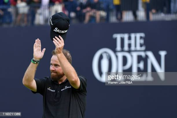 Shane Lowry of Ireland acknowledges the crowd as he leaves the 18th green following his third round of the 148th Open Championship held on the...