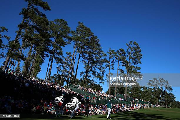 Shane Lowry of Ireland and amateur Bryson DeChambeau of the United States walk off the 14th tee box during the third round of the 2016 Masters...