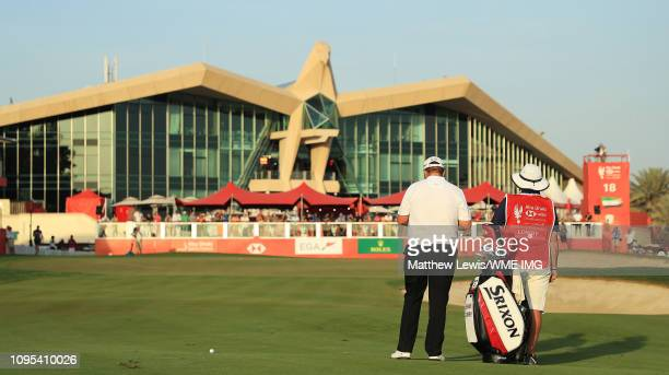 Shane Lowry of Ireland and caddie look on on the 18th fairway during Day Two of the Abu Dhabi HSBC Golf Championship at the Abu Dhabi Golf Club on...