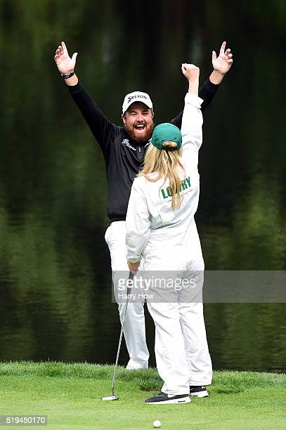 Shane Lowry of Ireland and fiancee Wendy Honner react during the Par 3 Contest prior to the start of the 2016 Masters Tournament at Augusta National...
