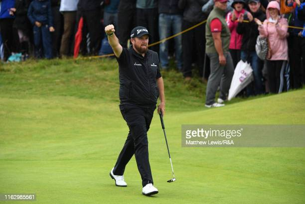 Shane Lowry of Ireland celebrates a putt on the tenth green during the second round of the 148th Open Championship held on the Dunluce Links at Royal...