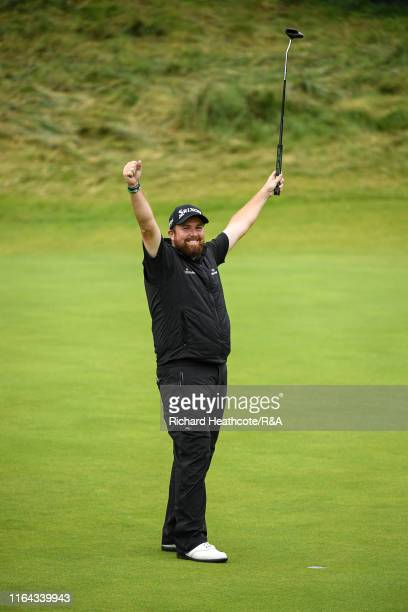 Shane Lowry of Ireland celebrates as he holes the winning putt securing victory during the final round of the 148th Open Championship held on the...
