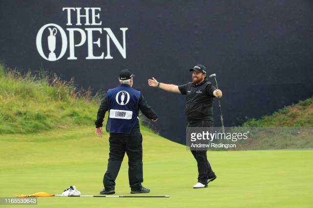 Shane Lowry of Ireland celebrates his victory with his caddie Brian Bo Martin on the 18th hole during the final round of the 148th Open Championship...