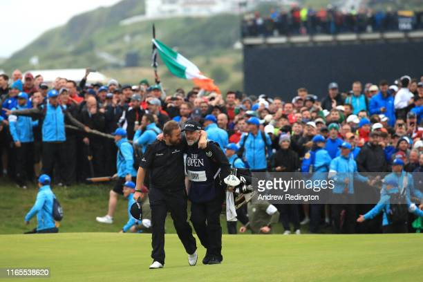 Shane Lowry of Ireland celebrates with caddie Bo Martin on the 18th hole during the final round of the 148th Open Championship held on the Dunluce...
