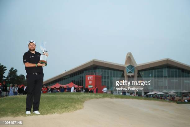 Shane Lowry of Ireland celebrates with the winner's trophy after Day Four of the Abu Dhabi HSBC Golf Championship at Abu Dhabi Golf Club on January...
