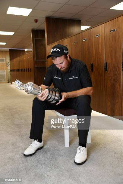 Shane Lowry of Ireland Champion Golfer of The Year 2019 pose for a photo with the Claret Jug following his victory of the 148th Open Championship...