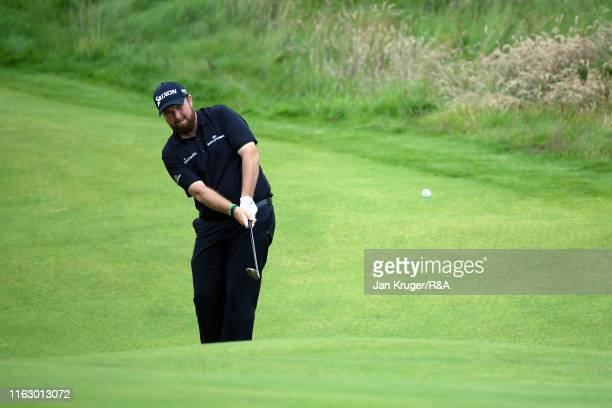 Shane Lowry of Ireland chips his third shot on the seventeenth hole onto the green during the second round of the 148th Open Championship held on the...