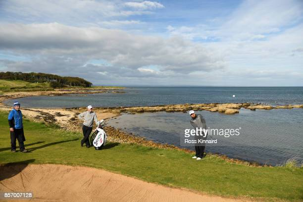Shane Lowry of Ireland chips onto the 12th green during practice prior to the 2017 Alfred Dunhill Links Championship at Kingsbarns on October 3 2017...