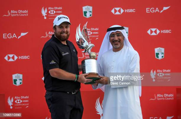 Shane Lowry of Ireland his presented with the trophy by Abdulfattah Sharaf the CEO of HSBC in Dubai after his one shot win during the final round of...