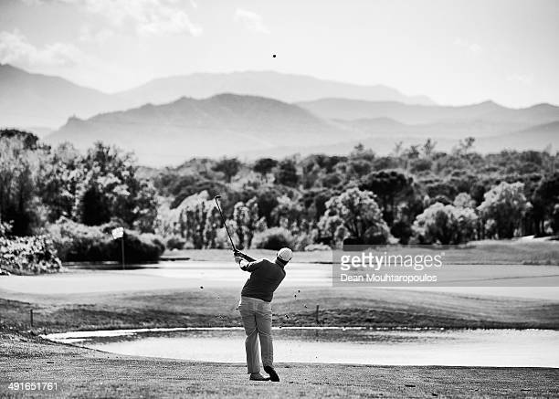 Shane Lowry of Ireland hits his second shot on the 13th hole during Day 1 of the Open de Espana held at PGA Catalunya Resort on May 15 2014 in Girona...