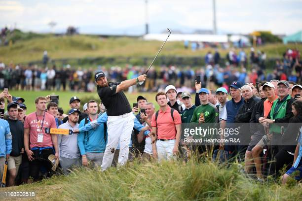 Shane Lowry of Ireland hits his second shot on the 14th hole during the third round of the 148th Open Championship held on the Dunluce Links at Royal...