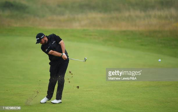 Shane Lowry of Ireland hits his second shot on the ninth hole during the second round of the 148th Open Championship held on the Dunluce Links at...