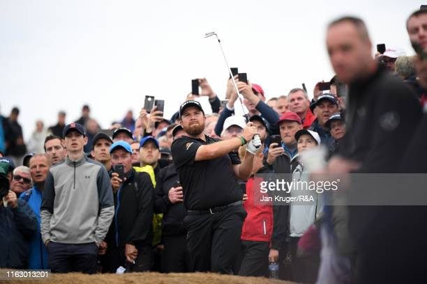 Shane Lowry of Ireland hits is second shot on the seventeenth hole during the second round of the 148th Open Championship held on the Dunluce Links...