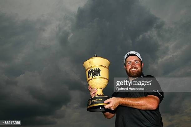 Shane Lowry of Ireland holds the Gary Player Cup after winning the World Golf Championships - Bridgestone Invitational during the final round at...