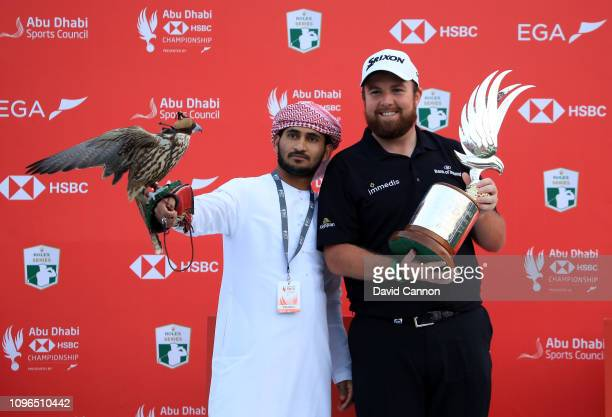 Shane Lowry of Ireland holds the trophy after his one shot win during the final round of the Abu Dhabi HSBC Golf Championship at the Abu Dhabi Golf...