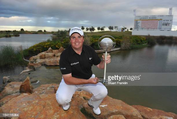Shane Lowry of Ireland holds the trophy after winning the Portugal Masters at the Victoria golf course at Villamoura on October 14 2012 in Faro...