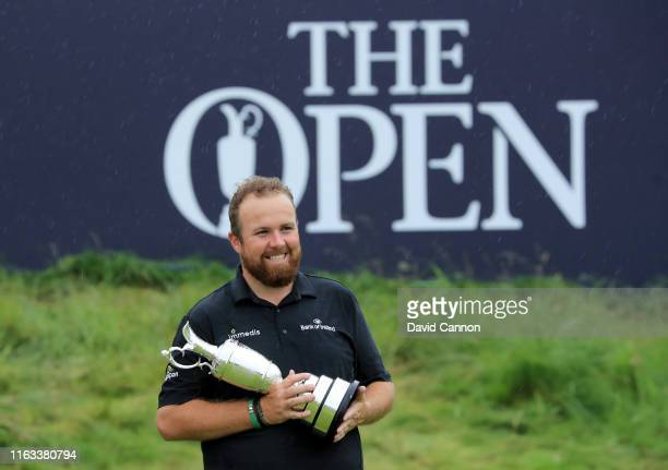 Shane Lowry of Ireland holds with the Claret Jug after his victory during the final round of the 148th Open Championship held on the Dunluce Links at...