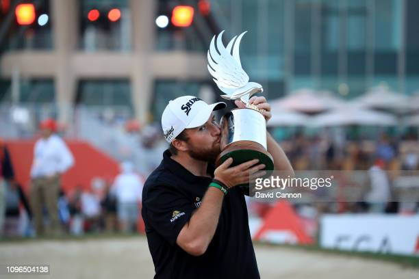 Shane Lowry of Ireland kisses the trophy after his one shot win during the final round of the Abu Dhabi HSBC Golf Championship at the Abu Dhabi Golf...
