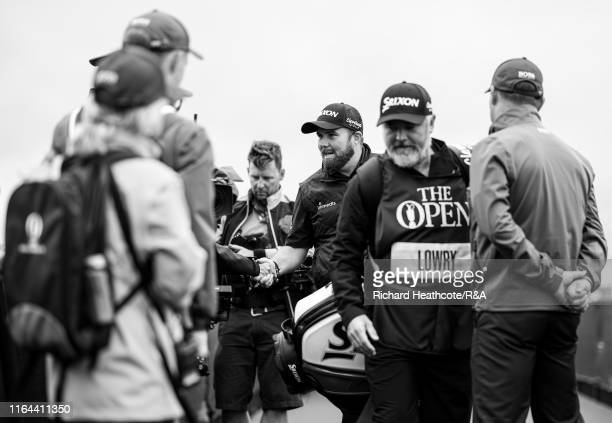 Shane Lowry of Ireland meets his walking scorers as he walks to the first tee during the final round of the 148th Open Championship held on the...