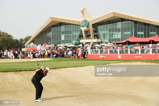 Shane Lowry of Ireland plays a shot from a bunker on the ninth hole during Day Four of the Abu Dhabi HSBC Golf Championship at Abu Dhabi Golf Club on...
