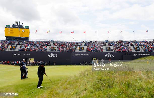 Shane Lowry of Ireland plays a shot on the 18th green during the first round of the 148th Open Championship held on the Dunluce Links at Royal...