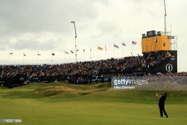 Shane Lowry of Ireland plays a shot on the 18th hole during the final round of the 148th Open Championship held on the Dunluce Links at Royal...