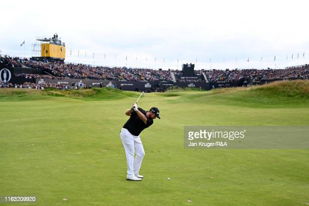Shane Lowry of Ireland plays a shot on the 18th hole during the third round of the 148th Open Championship held on the Dunluce Links at Royal...