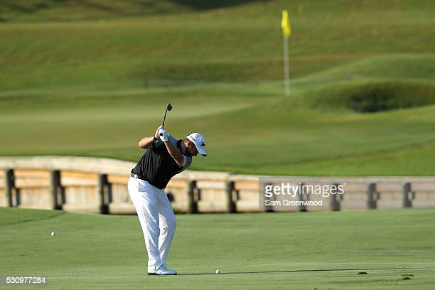 Shane Lowry of Ireland plays a shot on the fourth hole during the first round of THE PLAYERS Championship at the Stadium course at TPC Sawgrass on...