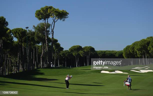 Shane Lowry of Ireland plays his second shot into the 12th green during the third round of the of the Turkish Airlines Open on November 3, 2018 in...