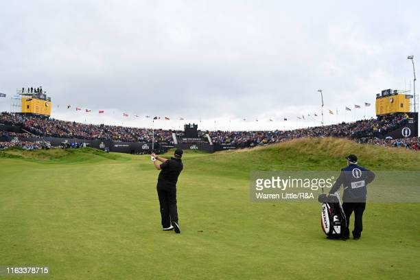 Shane Lowry of Ireland plays his second shot on the eighteenth hole during the final round of the 148th Open Championship held on the Dunluce Links...